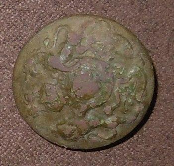 Metal detecting button